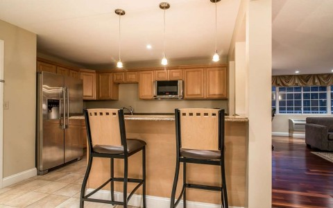 kitchen in suite with barstool seating