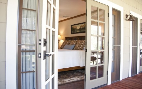 the french doors opening into a guest room
