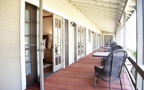 the veranda with french doors that open to guest rooms