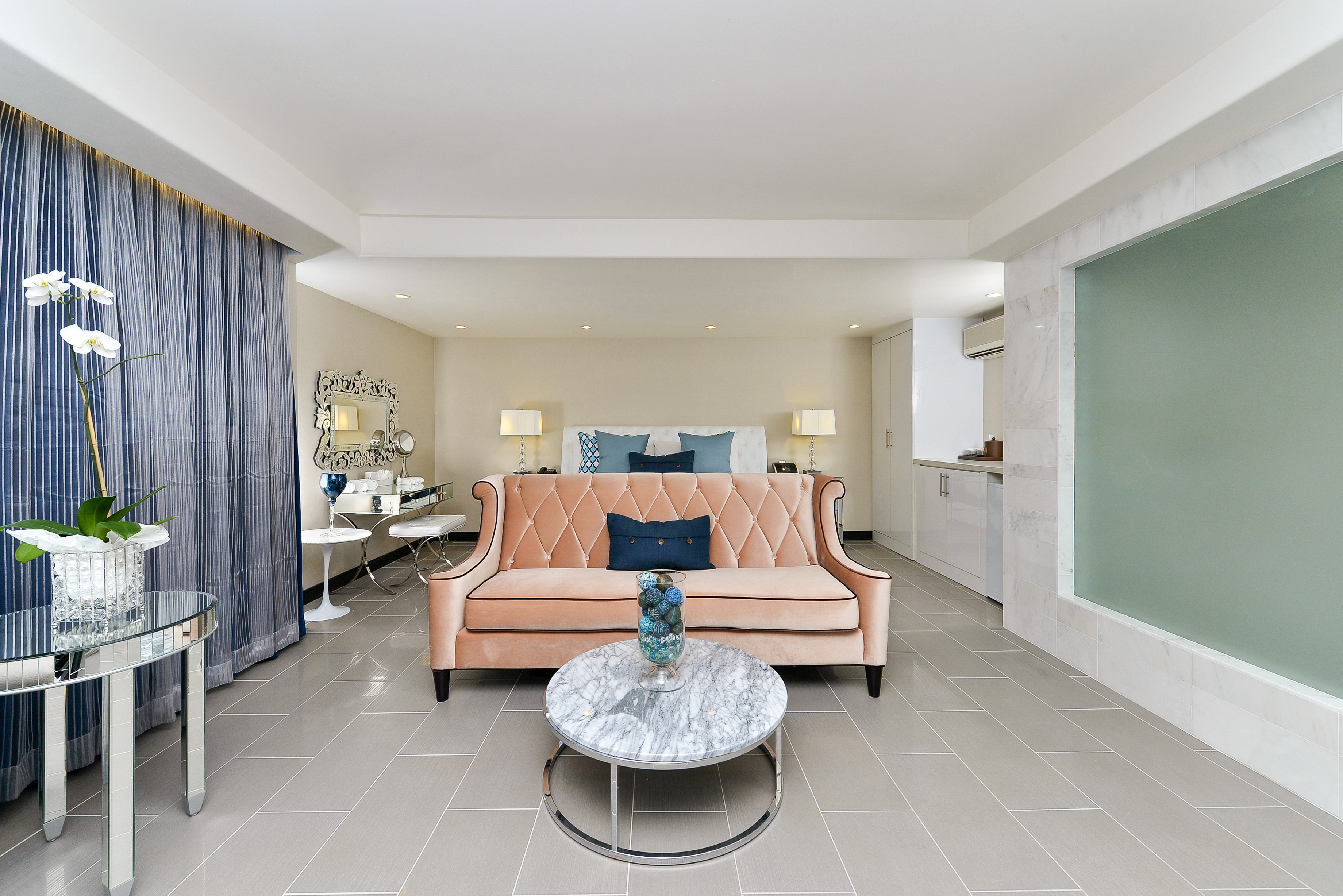 spacious guestroom with seating area