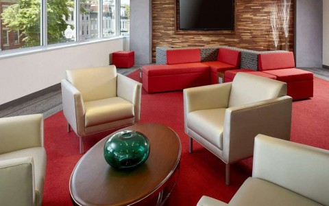 lounge area in lobby with seating and tv