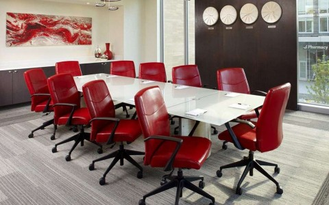 meeting room with conference table and red chairs