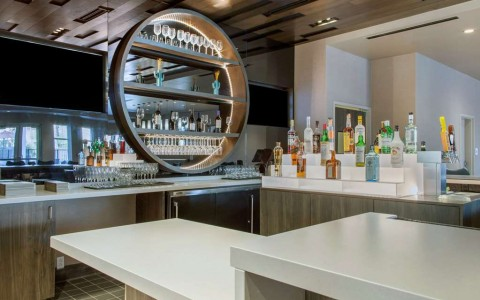Hotel bar with tiered liquor bottles