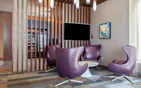 Hotel lobby with four purple chairs