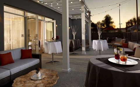 Outdoor event space with lounge seating and hightop tables