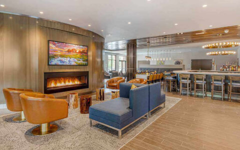 multiple seats near a fireplace in the lobby