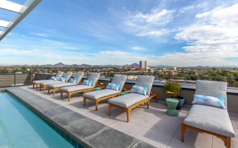 the rooftop pool deck with lounge chairs set up