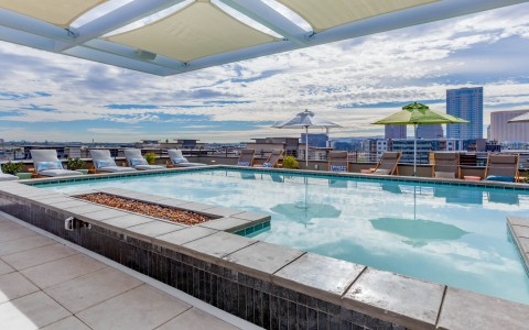 the rooftop pool deck with clouds overhead
