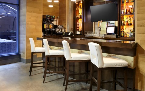 hotel bar with four barstools