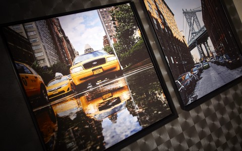 detail shot of artwork of new york city taxi cab hanging on wall