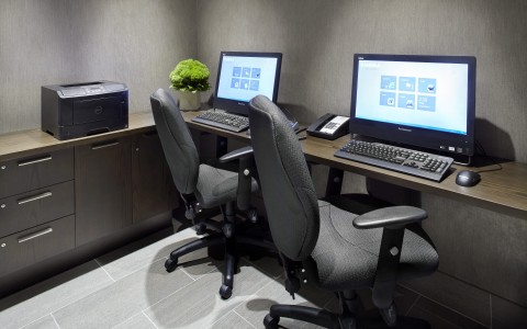 business center with computers and chairs