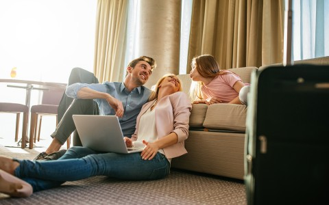 parents with daughter on couch in suite