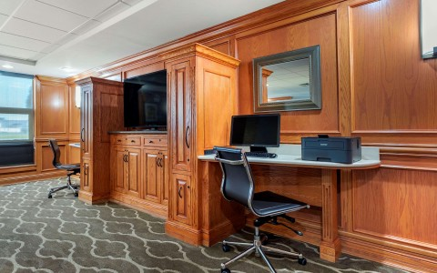Business center with computer, printer, and chair