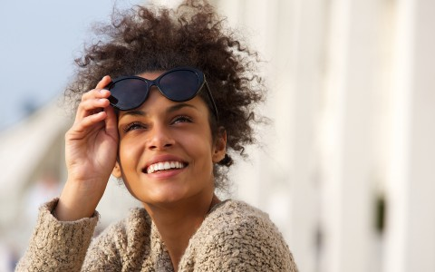 woman looking out with sunglasses over her head
