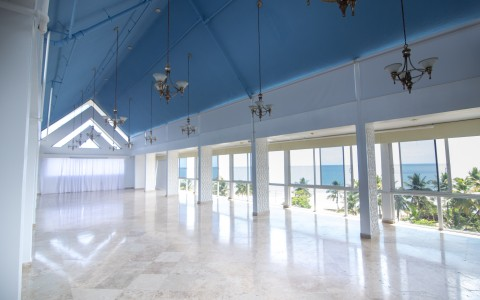 event space with vaulted ceiling and large windows